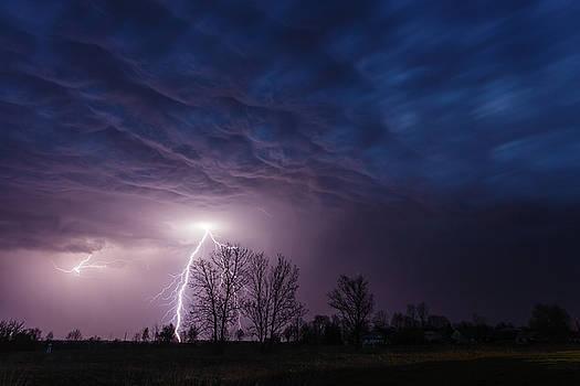 Lightning strike under dramatic sky by Lukasz Szczepanski