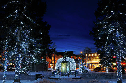 Reimar Gaertner - Lights on Elk antler arches and trees in Jackson Wyoming town sq
