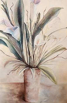 Lilies on a table by Chuck Gebhardt