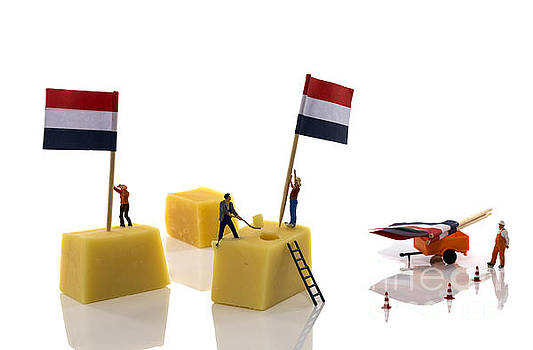 Compuinfoto   - little people putting flags on dutch cheese