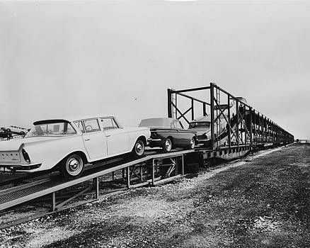 Loading Freight of Dodge Ramblers - 1961 by Chicago and North Western Historical Society