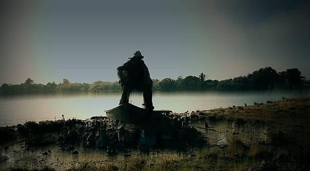 Lone Fisherman Statue by Julie Grace