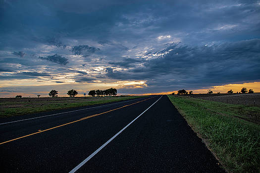Lone Highway At Sunset by Gaylon Yancy