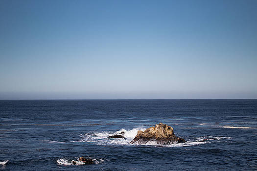 Lone rock in the ocean by Jingjits Photography