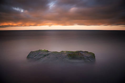Lone Stone at Sunrise by Adam Romanowicz