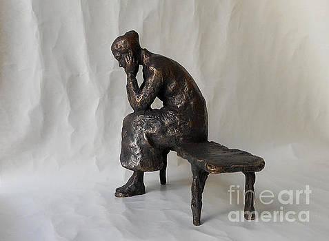 Lonely girl sitting on a bench. by Nikola Litchkov