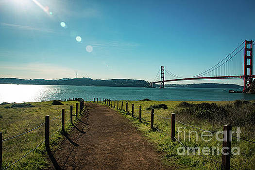 Lonely path with the golden gate bridge in the background by Amanda Mohler