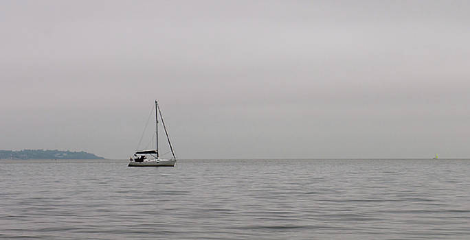 Lonely sailboat in the ocean by Michalakis Ppalis