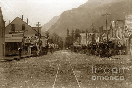 California Views Mr Pat Hathaway Archives - Looking down street with R/ R tracks Burrhard house White Pass and Yukon Route Railroad 1898