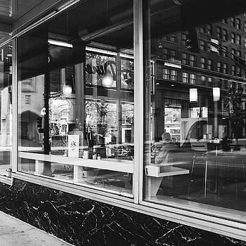 Looking into a diner. Black and white street photography. by Dylan Murphy