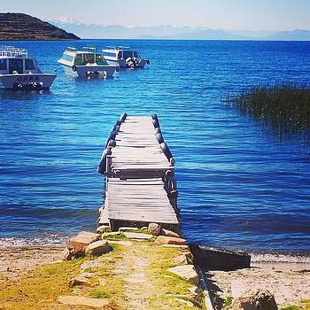 Looking Out Over Lake Titicaca Towards by Dante Harker