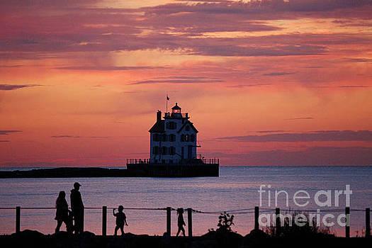 Lorain Lighthouse Sunset by Debbie Parker