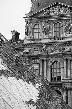 Louvre reflection by Hitendra SINKAR
