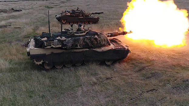M1a3 Abrams tank fires a round during a live fire training exercise by Paul Fearn