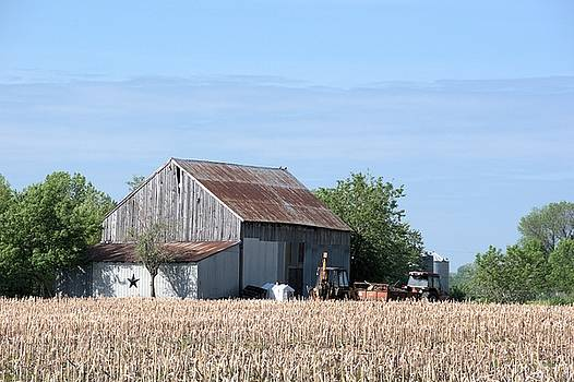 Valerie Kirkwood - Machine Shed by a Corn Field