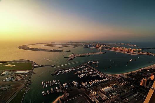 Majestic colorful dubai palm island during beautiful sunset. Dubai marina, United Arab Emirates. by Marek Kijevsky