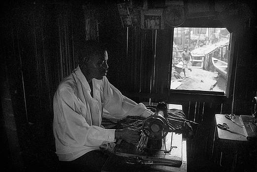 Muyiwa OSIFUYE - A tailor at work