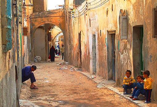 Man and kids in the Old City. by Bill Vernon
