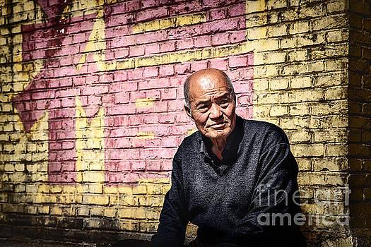 Man in a quiet achieve by Adrian Baljeu