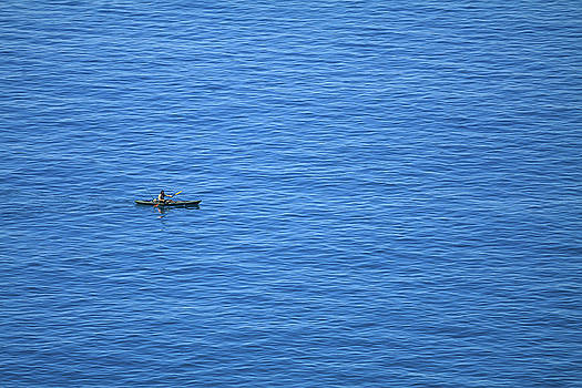 Man in canoe paddle by Cristian Mihaila