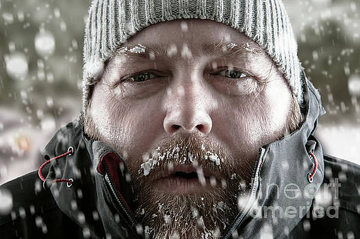 Man in snow storm close up by Simon Bratt Photography LRPS