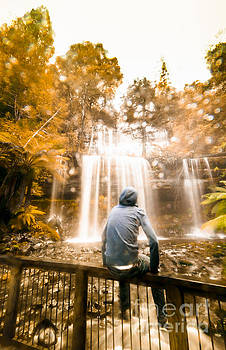 Man looking at waterfall by Jorgo Photography - Wall Art Gallery