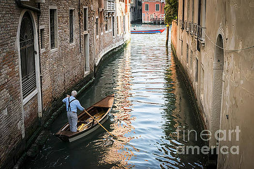 Man on a boat in Venice by Deyan Georgiev