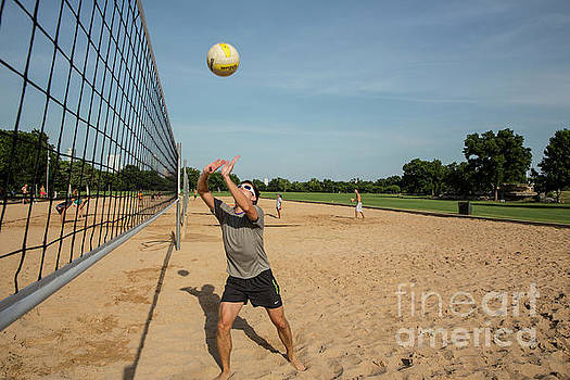 Herronstock Prints - Man playing volleyball returns the ball under a clear blue sky at Zilker Park sand volleyball courts