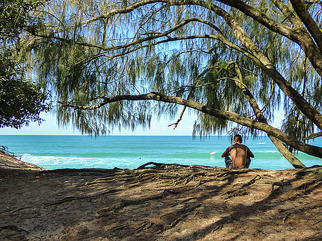 Man relaxing at the beach by Helissa Grundemann