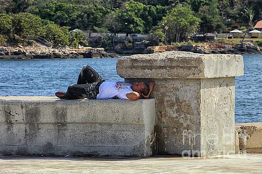 Patricia Hofmeester - Man sleeping on a wall