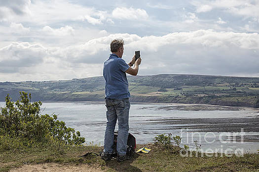Patricia Hofmeester - Man taking picture of view near Robin Hood