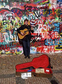 Man with a Guitar by The Lennon Wall. Chrispy Cheeks. Mala Stra by Jouko Lehto