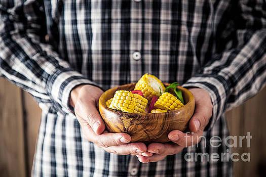 Man with snacks by Mythja Photography