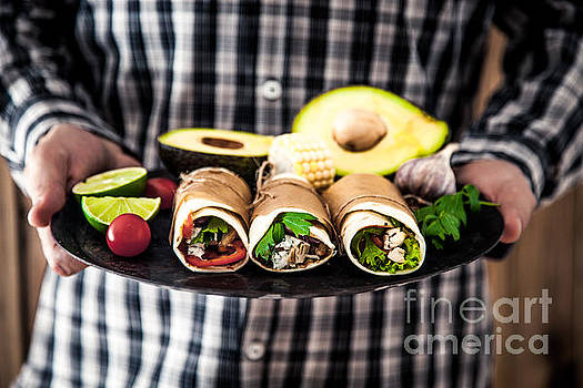 Man with tortilla by Mythja Photography