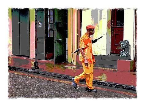 Man With Umbrella on Bourbon Street by Eduardo Tavares