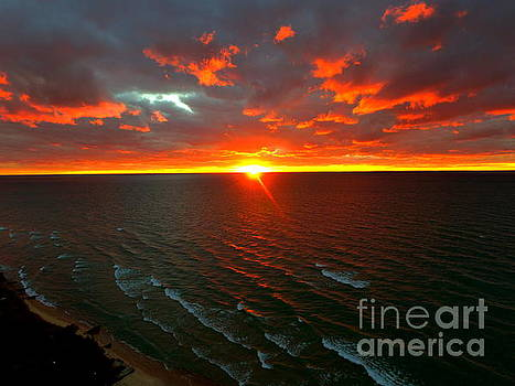 Manistee Michigan Waves Of Fire by Jack Martin