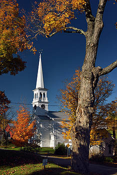 Reimar Gaertner - Maple trees and white church with clock tower in Peacham Vermont