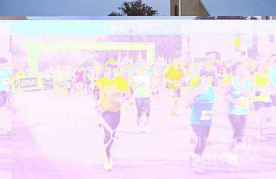 Herronstock Prints - Marathon runners at the start line at the Austin Marathon and Half Marathon in downtown Austin Texas