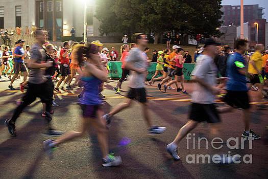 Herronstock Prints - Marathon runners in action at the Austin Marathon and Half Marathon in downtown Austin Texas