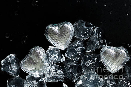 Melt my heart concept with silver wrapped chocolates by Simon Bratt Photography LRPS