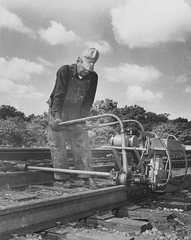 Chicago and North Western Historical Society - Man Working on Track