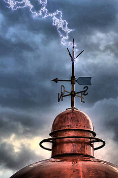 Pedro Cardona Llambias - Menorca copper lighthouse dome with lightning rod under a bluish and stormy sky and lightning effect