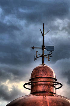 Pedro Cardona Llambias - Menorca copper lighthouse dome with lightning rod under a bluish and stormy sky