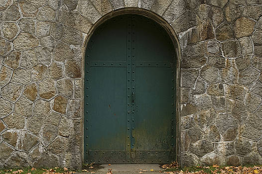 Metal Door in Stone Wall by Michael Wall