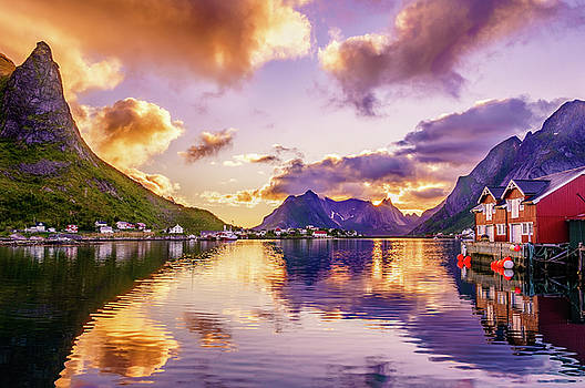 Midnight sun reflections in Reine by Dmytro Korol