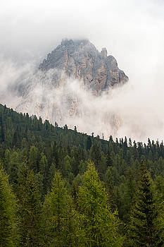 Mighty Dolomite peaking through the clouds by Wim Slootweg