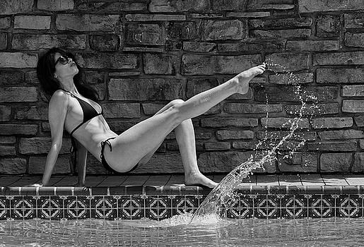 Mika Kicks The Water 1 by Doug Mathewson
