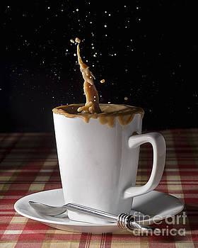 Milk Splash in a Coffee Cup by Art Whitton