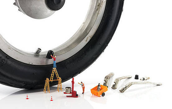 Compuinfoto - miniature people slices flat tire with valve