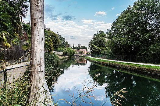 Mirror On A River by Fabio Belloni